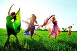 girls-playing-and-frolicking-in-field-300x199