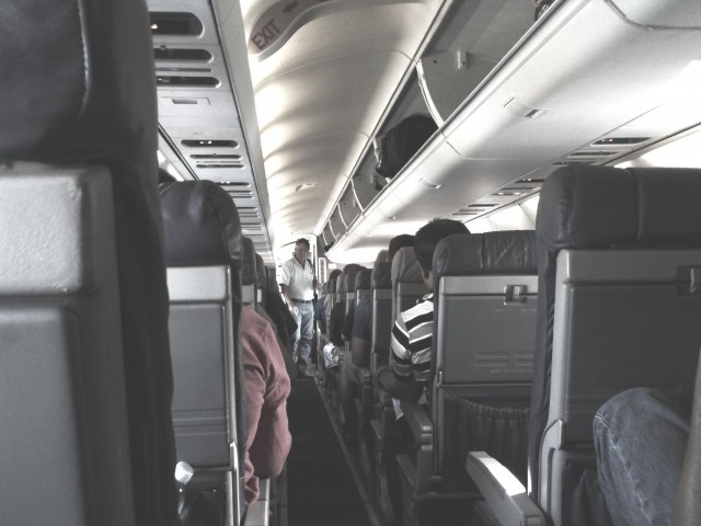 boarding-airplane-aisle-640x480